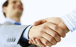 home buyer and real estate agent shaking hands