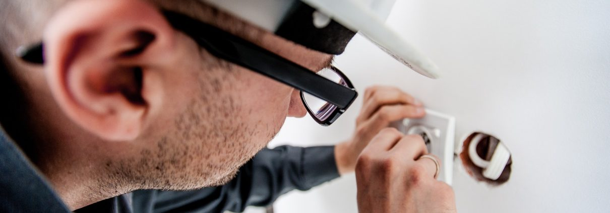 Man repairing an outlet