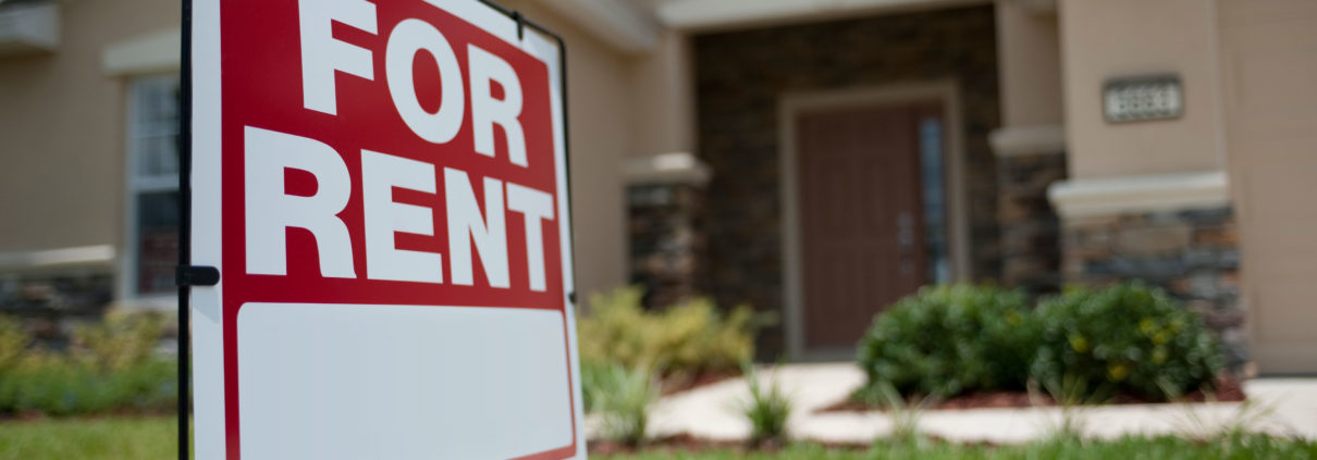 """Red colored """"For Rent"""" sign with flesh colored house as a background"""