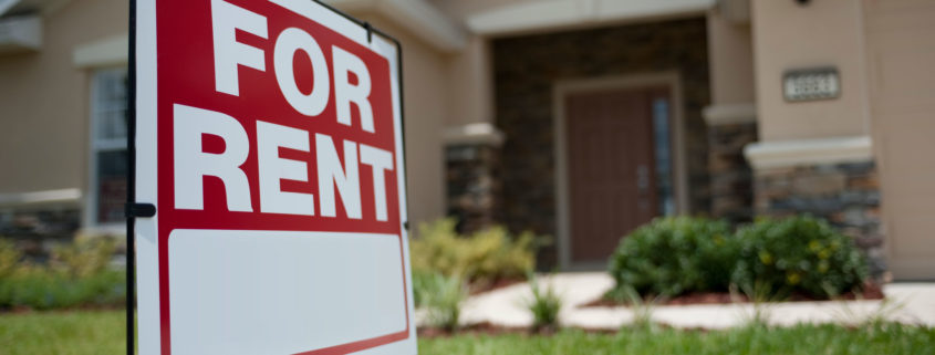 "Red colored ""For Rent"" sign with flesh colored house as a background"