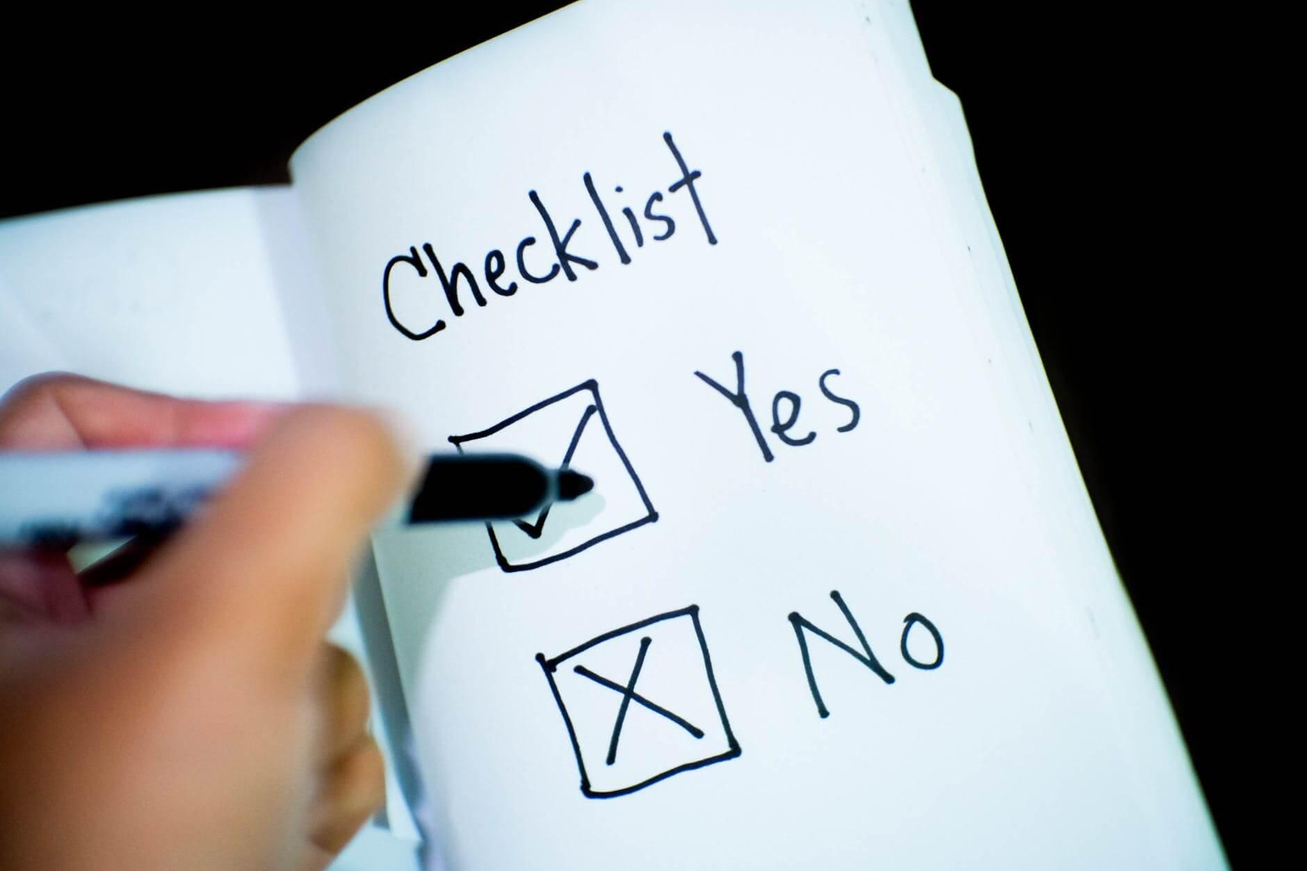 checklist written white notebook